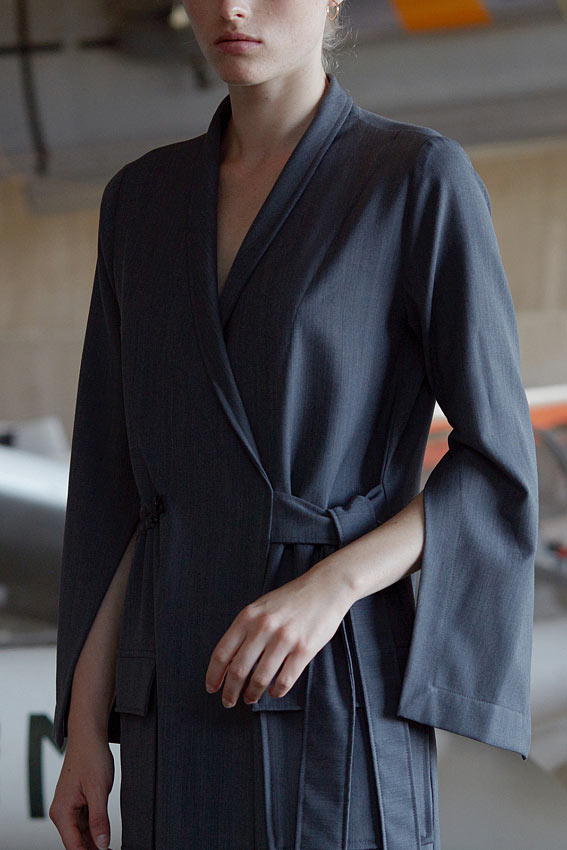 Model wearing grey wrap long sleeve midi dress with pockets close-up