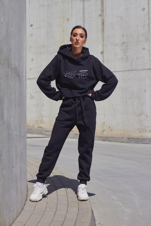 Juodos moteriškos laisvalaikio kelnės iš organiškos medvilnės, su kišenėmis ir raišteliais