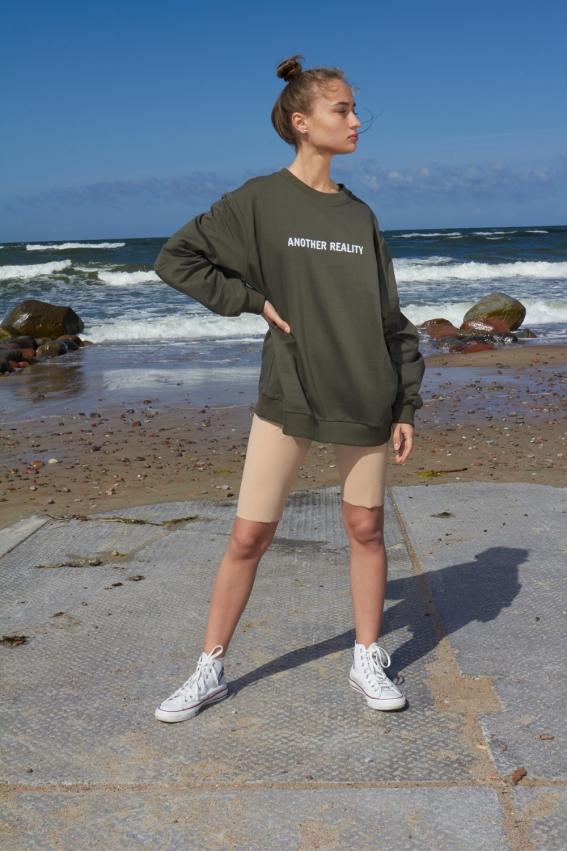 Model is wearing khaki unisex embroidered sweatshirt