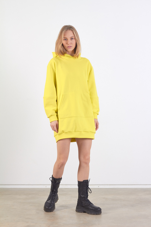 Model is wearing long yellow unisex sweatshirt