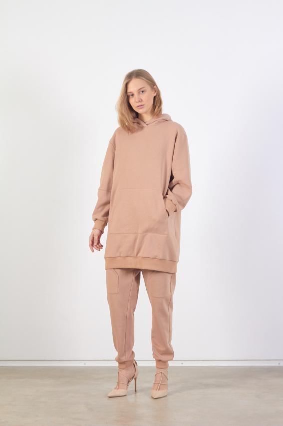 Model is wearing long beige unisex sweatshirt