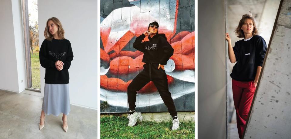 Modelis dėvi juodą unisex džemperį su užrašu