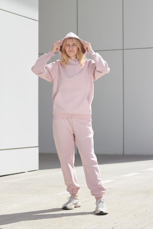 model is wearing pink hoodie