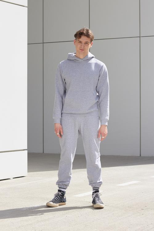 model is wearing grey hoodie