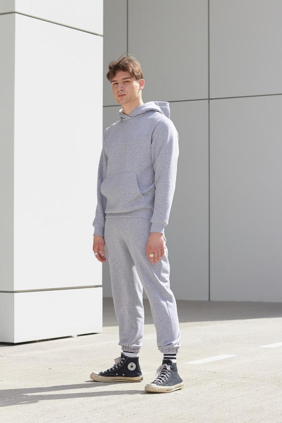 model is wearing grey jersey jogger pants