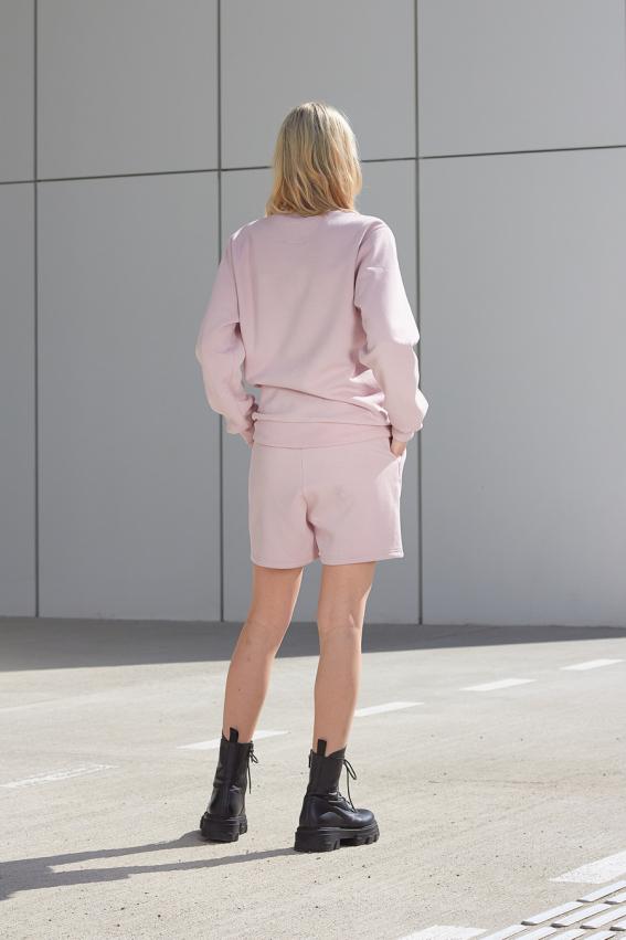 Model is wearing pink jersey shorts
