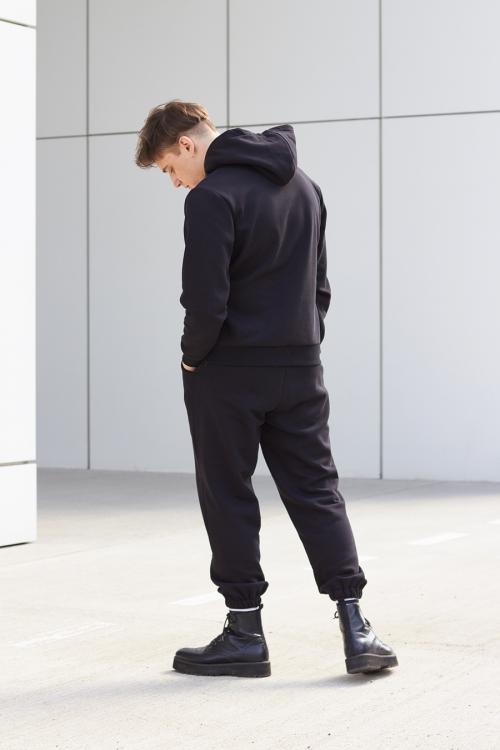 model is wearing black jogger pants