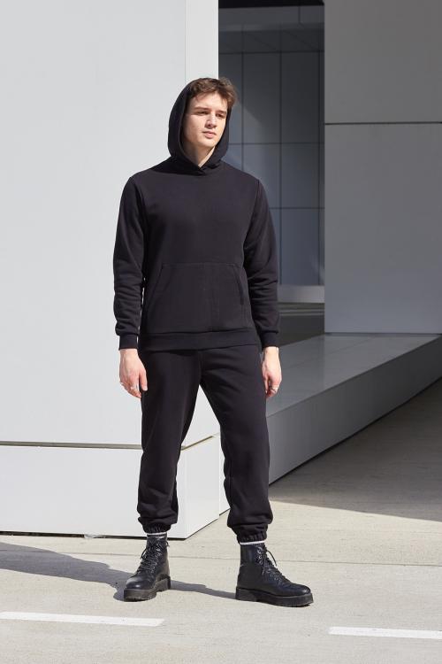 model is wearing black hoodie
