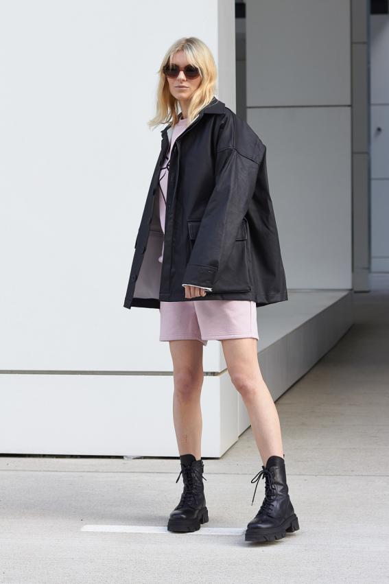 model is wearing black oversized jeans jacket