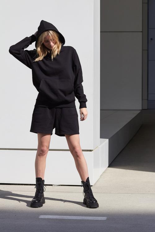 model is wearing black jersey shorts