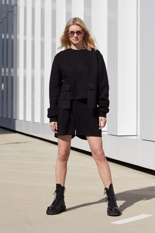 model is wearing black cropped sweatshirt