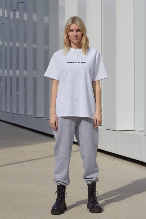 model is wearing grey jogger pants