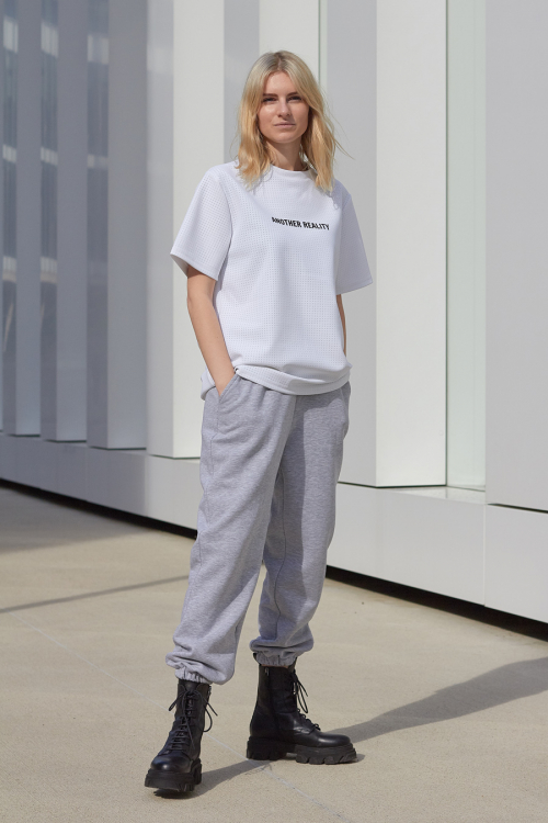 Model is wearing white t-shirt