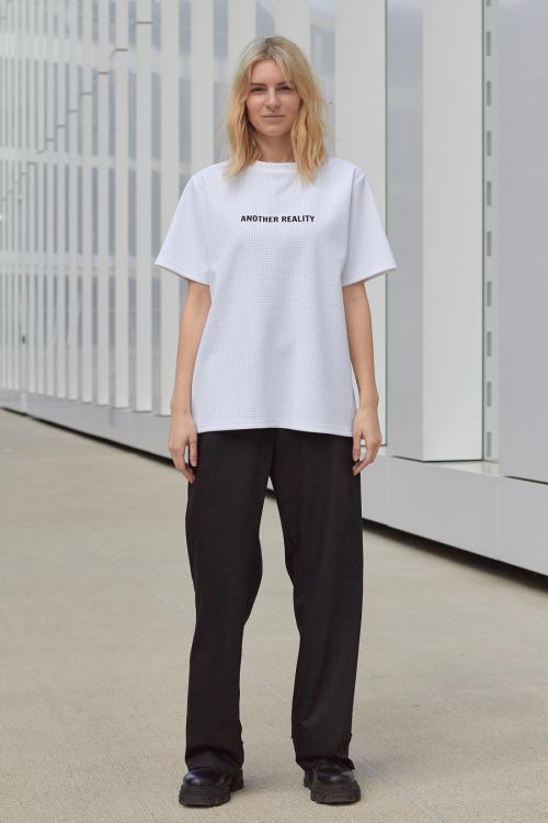 model is wearing wide black pants