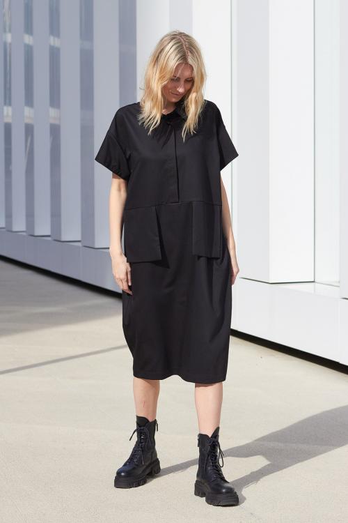model is wearing black shirt type dress